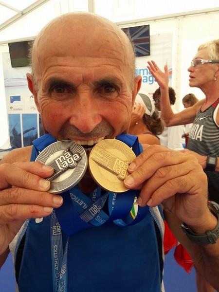 Ettorino Formentin con le due medaglie conquistate sulla 10k, ne vincera' altre due sulla 20km di marcia e un sulla 5km